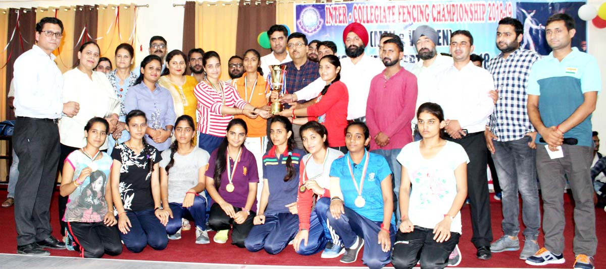 Winners of Fencing Championship posing along with dignitaries and officials.