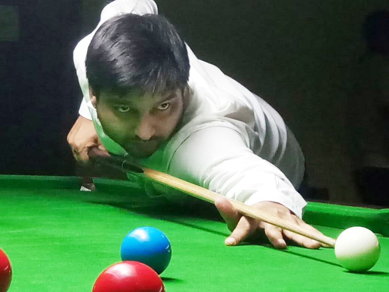A cueist aiming at target during his match at Billiards Hall, MA Stadium, Jammu on Friday. —Excelsior/Rakesh