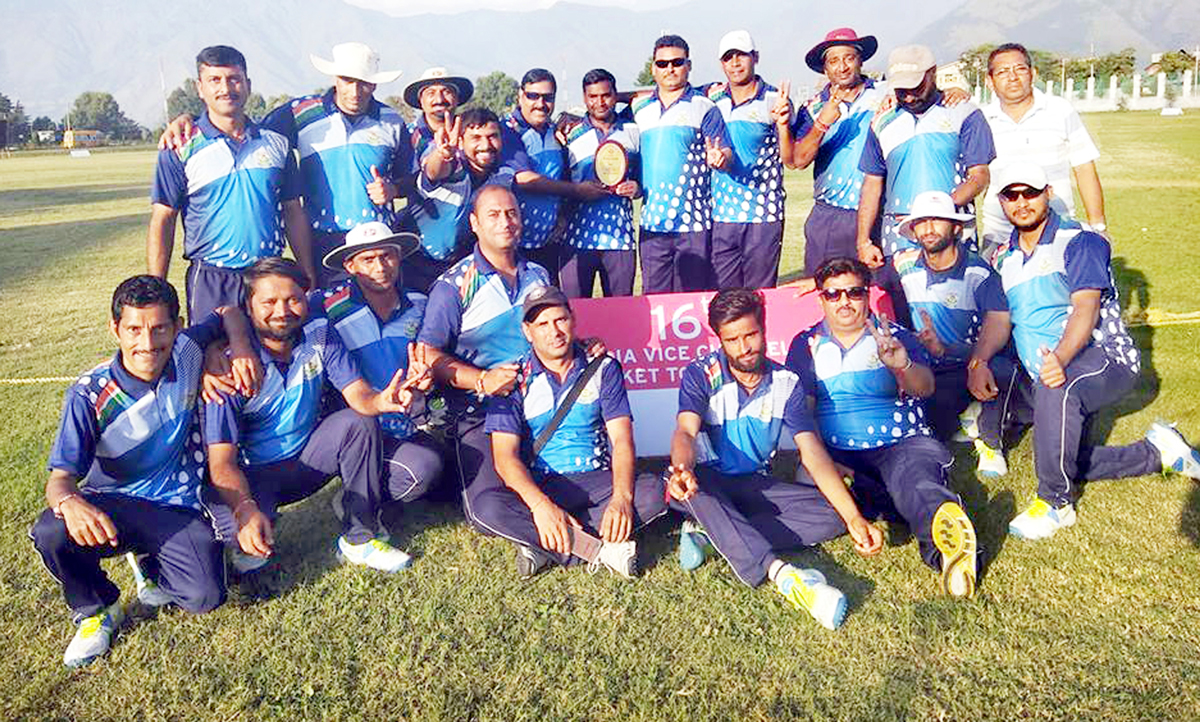 JU's Employees Cricket team posing for a group photograph after entering into finals of Vice Chancellors Cup.