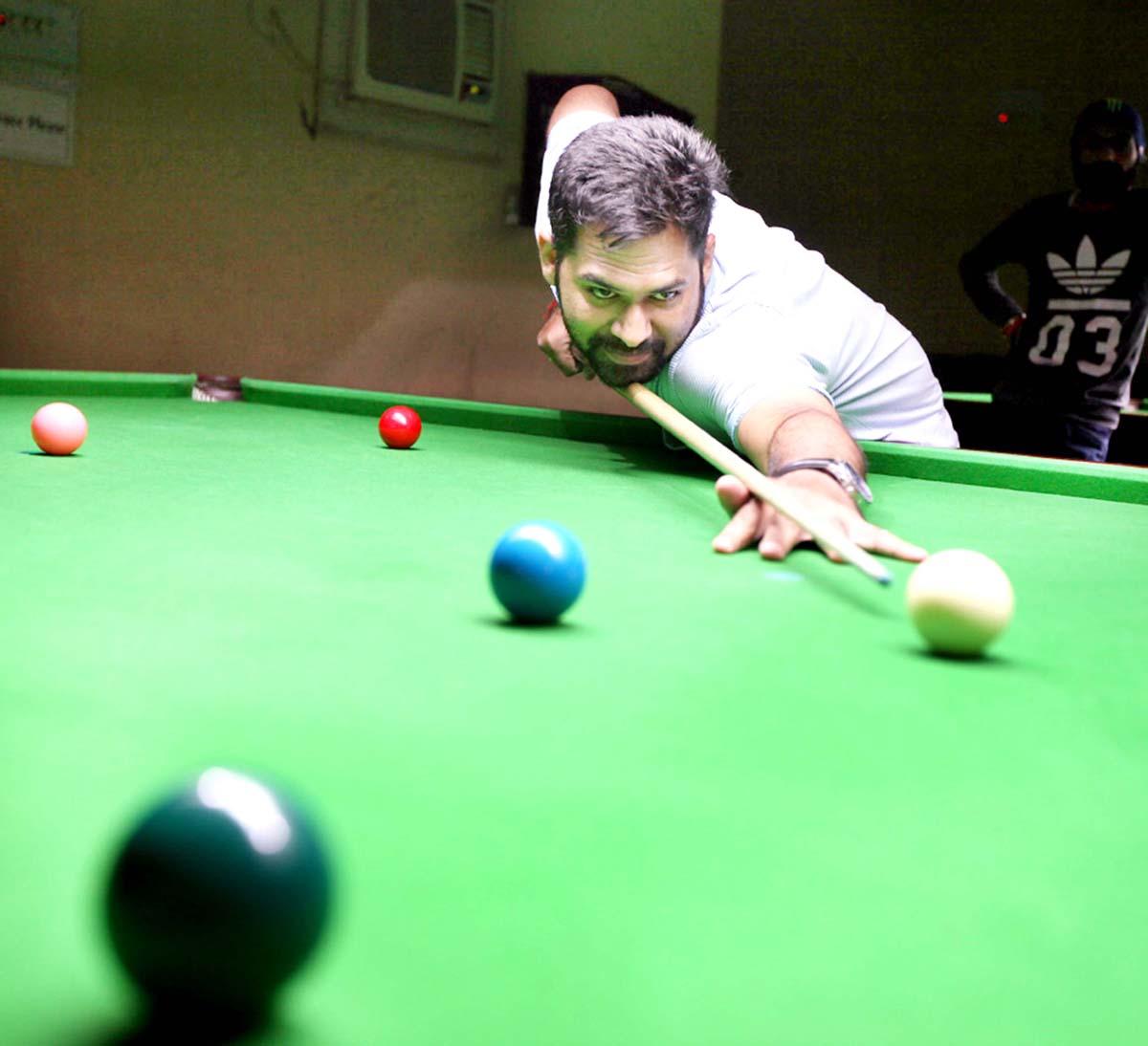 Cueist in action at Billiards Hall, MA Stadium in Jammu on Saturday. -Excelsior/Rakesh
