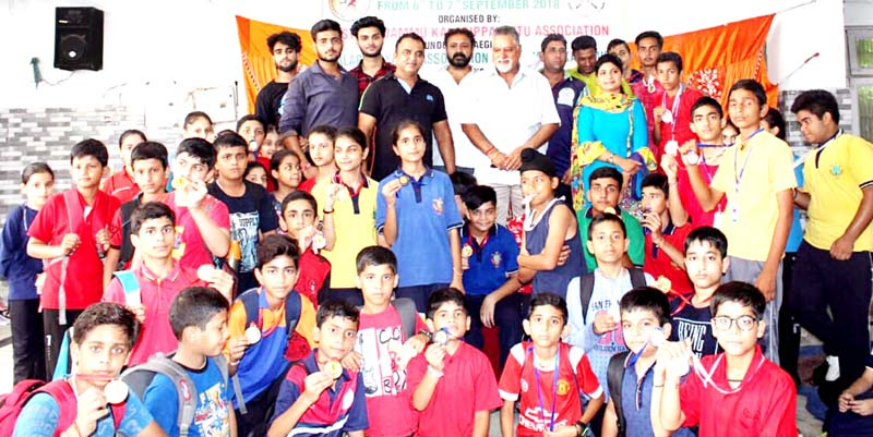 Winners of 1st District Jammu Kalarippayattu Championship posing along with dignitaries and officials in Jammu.