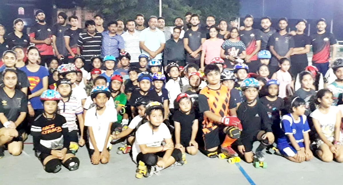 Players posing along with chief guest and other dignitaries during inaugural function of Rollball Championship in Jammu.