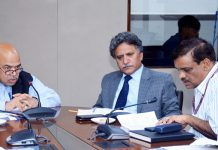 Advisor Khurshid Ahmed Ganai and Union Agriculture Secretary S K Pattnayak in a meeting at New Delhi on Thursday.
