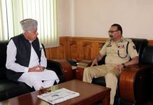 NC chief, Farooq Abdullah interacting with DGP, Dilbag Singh at Srinagar on Saturday.