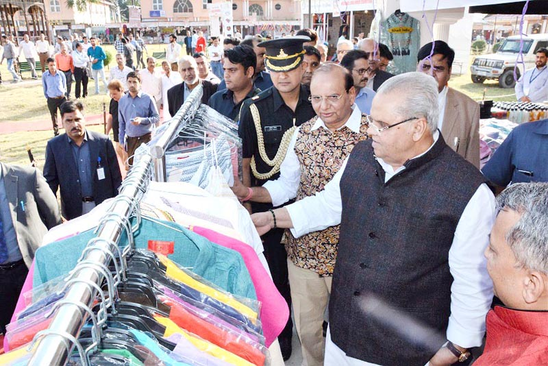 Governor SP Malik looking at products at exhibition of J&K Khadi & Village Industries Board in Srinagar on Tuesday.