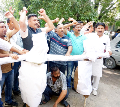 AJKPC members staging protest against NC and PDP in Jammu on Tuesday.