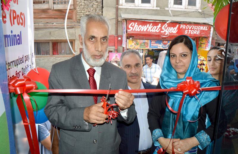 J&K Bank officials inaugurating ATM at Kamangarpora of Downtown, Srinagar.