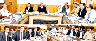 Justice Ali Mohammad Magrey chairing a meeting in Srinagar on Monday.
