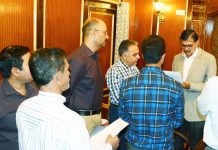 Advisor K Vijay Kumar interacting with a delegation in Srinagar on Wednesday.