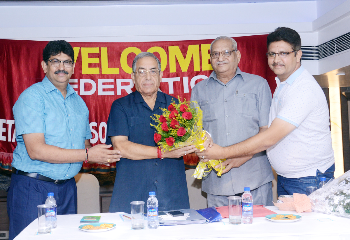Noted city businessman, Yash Paul Gupta being felicitated after being re-elected as president of the Federation of Retailers Association in Jammu on Sunday.