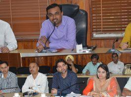 DC Ramesh Kumar chairing a meeting in Jammu on Thursday.