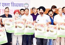 CTF members displaying banners projecting their demands after meeting in Jammu on Tuesday.