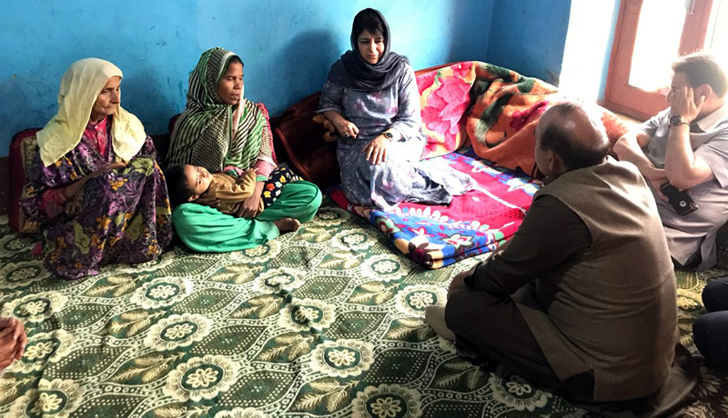 PDP president Mehbooba Mufti at the residence of rape and murder victim at Boniyar in Uri. -Excelsior/Aabid Nabi
