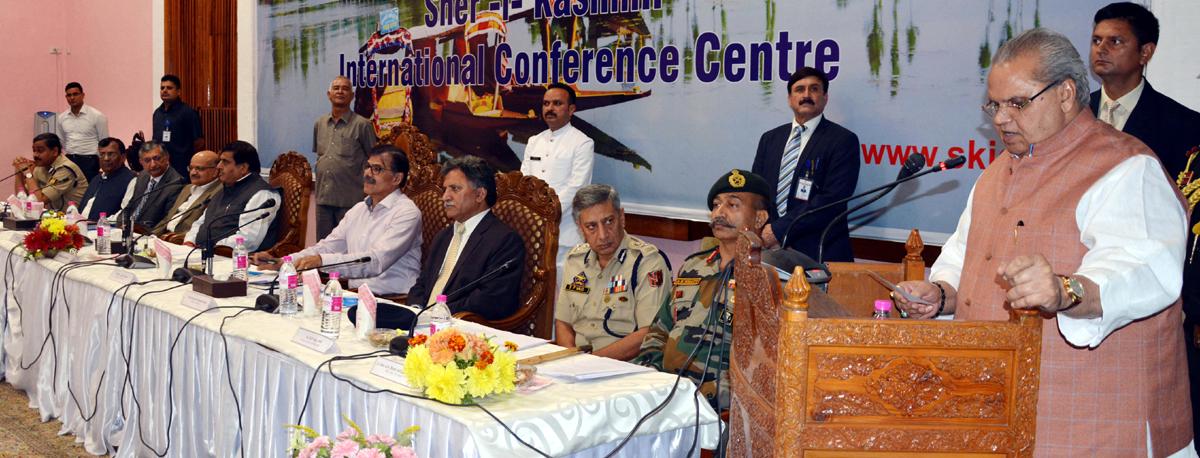 Governor S P Malik addressing gathering during post yatra review meeting at SKICC, Srinagar.