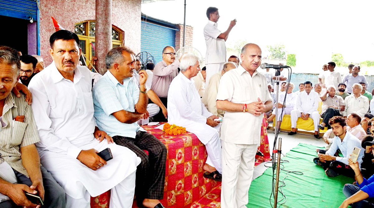 Former DyCM, Tara Chand addressing public meeting at Khour on Sunday.