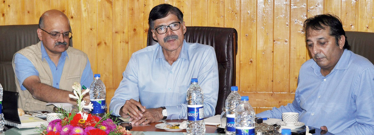 Advisor K Vijay Kumar chairing a meeting in Pulwama on Monday.