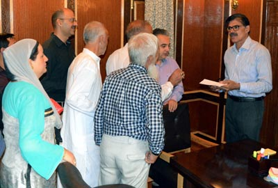 Advisor to Governor K Vijay Kumar interacting with a delegation on Wednesday.