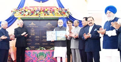 Prime Minister Narendra Modi formally inaugurating the Sikkim's first ever Airport and displaying the Airport Manual, at Pakyong on Monday.