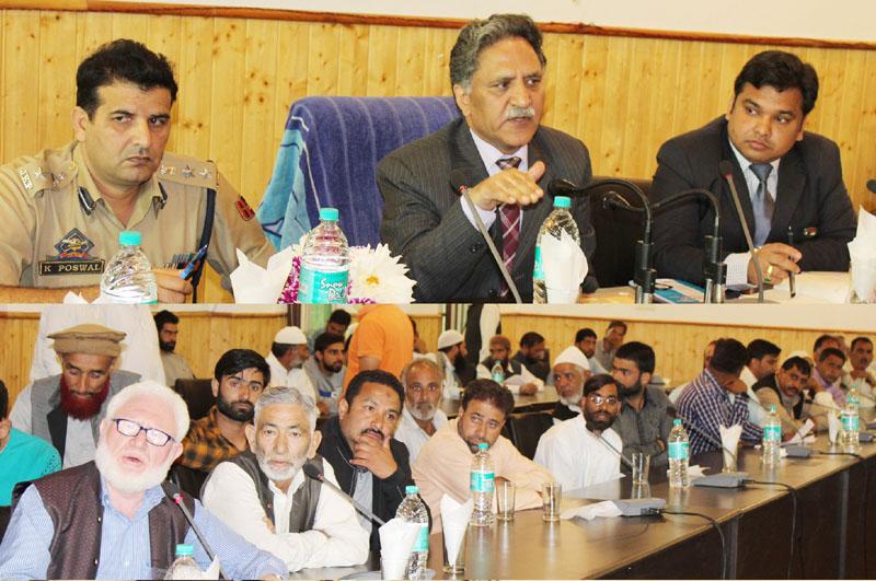 Advisor Khursheed Ahmad Ganai chairing a grievance redressal camp at Ganderbal on Thursday.