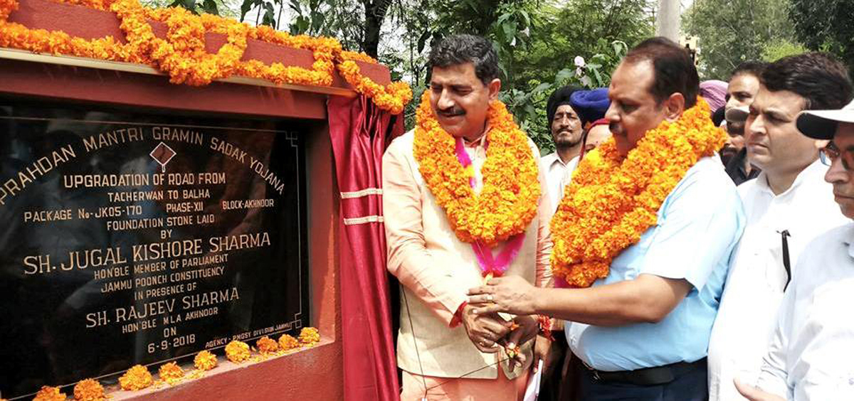 MP Jugal Kishore Sharma and MLA Rajeev Sharma laying foundation stone of PMGSY road in Akhnoor on Thursday.