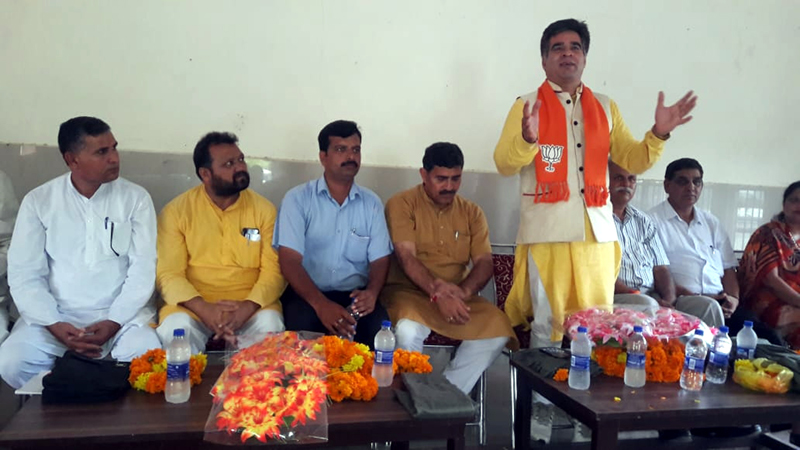 BJP State president, Ravinder Raina addressing workers Sammelan at Chamb on Friday.