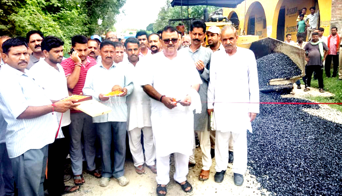 Former Minister and MLA Vijaypur C P Ganga kick starting work on Rajinder Singh Pora road on Sunday. -Excelsior/Gautam