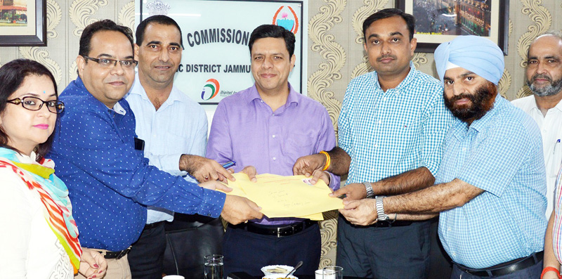 Divisional Commissioner launching postal delivery of PRCs.
