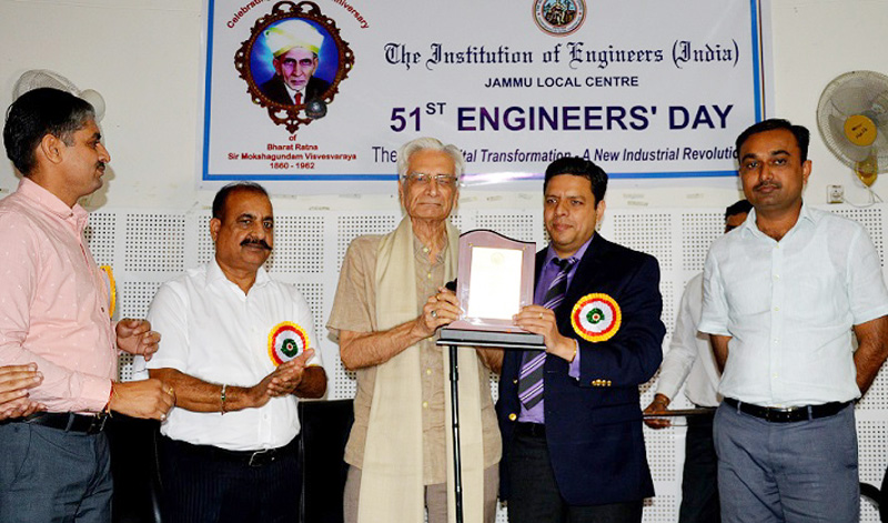 Divisional Commissioner Jammu Sanjeev Verma honouring an engineer during a function in Jammu on Saturday.