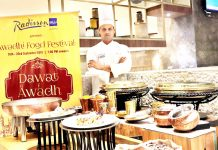 "A chef showcasing the cuisines to be served to the customers during ""Dawat-e-Awadh"" fest."