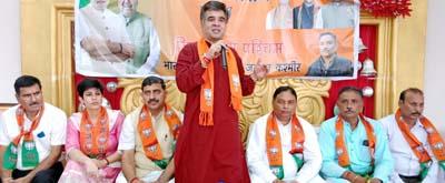 BJP State president Ravinder Raina addressing a Karyakarta Sammelan at Jammu on Wednesday.
