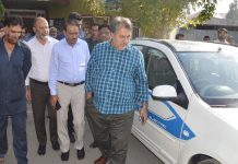 Principal Secretary Transport Asgar Samoon examining the first electric car introduced by SMG in Srinagar on Tuesday.