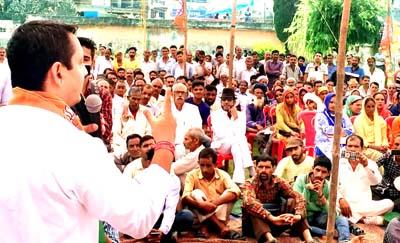 MLA R S Pathania addressing a public meeting at Ramnagar on Sunday.