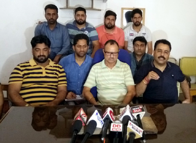 Chairman Cross LoC Traders Association Pawan Anand addressing press conference at Poonch. — Excelsior/Ramesh Bali
