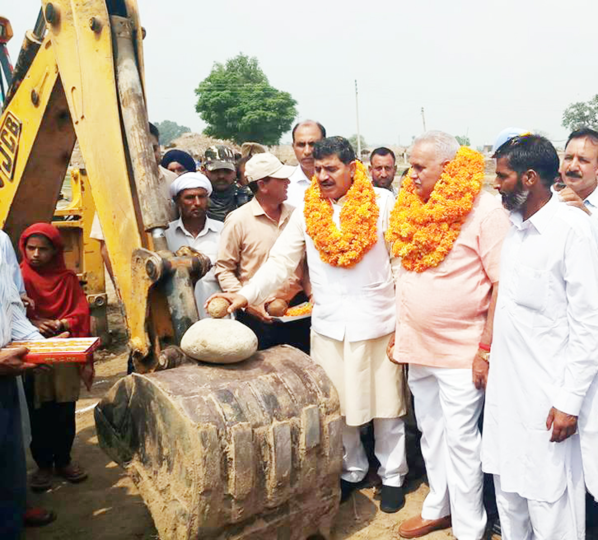 MP, Jugal Kishore Sharma kick starting construction of community bunkers at village Jeora in Suchetgarh constituency on Tuesday.