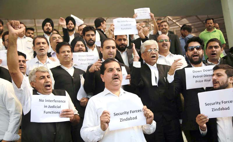 Lawyers protesting in District Court Complex at Janipur on Friday. -Excelsior/ Rakesh