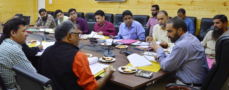 Director Information & Public Relations chairing a meeting in Srinagar on Tuesday.