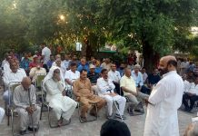 Former Minister and MLA, Bali Bhagat addressing public meeting in Raipur-Domana constituency on Thursday.