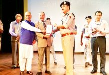 Director SKPA Suleman Salaria, IGP Jammu Zone Dr SD Singh and others launching SAHULAT Office App and 'Ujadta Chaman' movie.