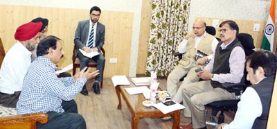 Advisor K Vijay Kumar & Chief Secretary BVR Subrahmanyam listening to public grievances on Monday.