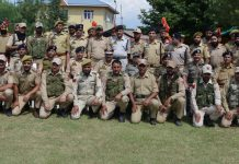 DGP Dilbagh Singh and police personnel posing for group photograph.