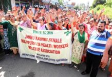 FMPHWs taking out a rally to the office of Divisional Commissioner, Jammu. -Excelsior/ Rakesh