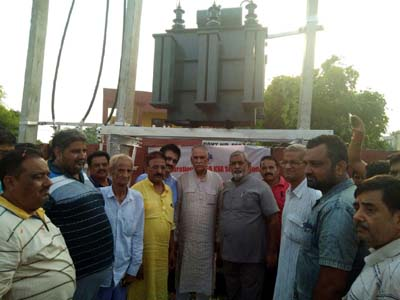 MP (RS) Shamsher Singh Manhas inaugurating a transformer at Paloura on Wednesday.