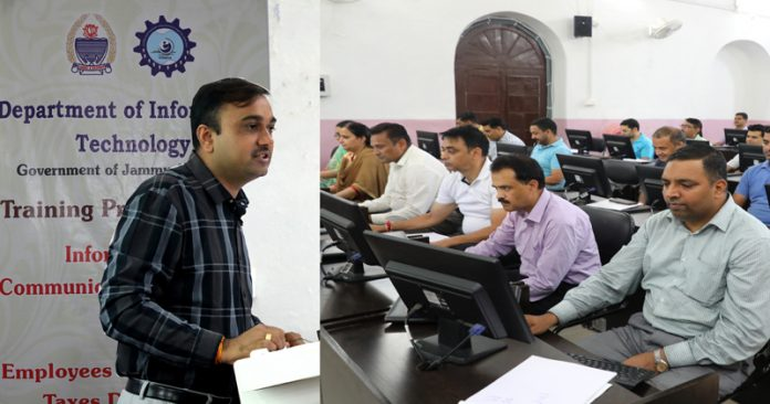 DC Jammu delivering lecture to employees of Commercial Taxes during a training programme.