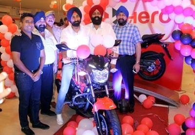 SSP Jatinder Singh Johar, Secretary CCI Gourav Gupta and others launching 'Xtreme 200R' at Devika Automobiles on Tuesday.