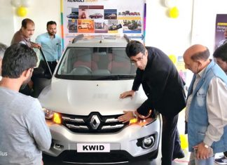 Officials of Srinagar Automotive Private Limited briefing customers about features of all-new feature loaded Kwid.