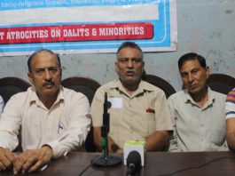 Bodh Raj Bhagat, President of socio-religious wing of JKRCEA addressing a press conference at Jammu on Saturday.