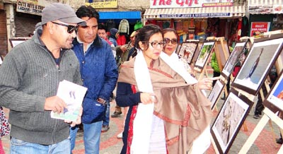 DC Avny Lavasa looking at photos during an exhibition on 3rd-day of Ladakh Festival in Leh on Monday.