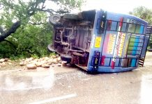 An ill fated mini-bus which turned turtle in Nagrota area in outskirts of Jammu.