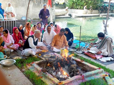 Kashmiri Pandits performing havan on Anant Chaturdashi at Nagbal on Monday.