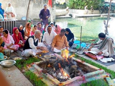 Kashmiri Pandits performing havan on Anant Chaturdashi at Nagbal on Monday.